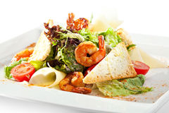 Caesar Salad. Seafood Caesar Salad with Shrimps, Salad Leaf, Croutons, Cherry Tomato and Parmesan Cheese stock image