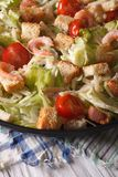 Caesar salad with shrimp close-up on a plate. Vertical Royalty Free Stock Photo