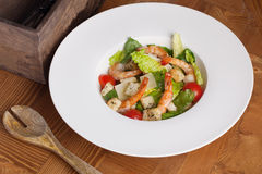 Caesar salad with shrimp on a plate Stock Photo
