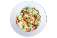 Caesar salad with shrimp on a plate Stock Images