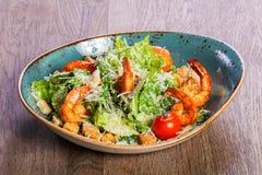 Caesar salad with shrimps. And parmesan cheese stock photos