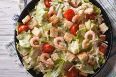 Caesar salad with shrimps horizontal top view closeup Royalty Free Stock Photography