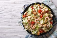 Caesar salad with shrimps horizontal top view Royalty Free Stock Photography