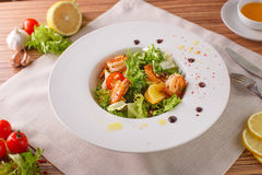Caesar salad with shrimps and iceberg leaves Royalty Free Stock Photos