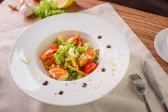 Caesar salad with shrimps and iceberg leaves Royalty Free Stock Photography