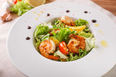 Caesar salad with shrimps and iceberg leaves Stock Image