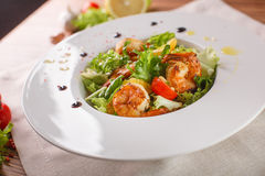 Caesar salad with shrimps and iceberg leaves Royalty Free Stock Image