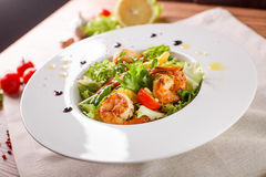 Caesar salad with shrimps and iceberg leaves Royalty Free Stock Photo
