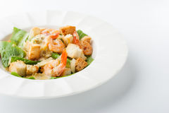 Caesar salad with shrimps on the white background horizontal Stock Images