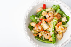 Caesar salad with shrimps on the white background top view Stock Photo