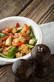 Caesar salad with shrimps on the wooden table Royalty Free Stock Photos