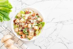 caesar salad on table Royalty Free Stock Image