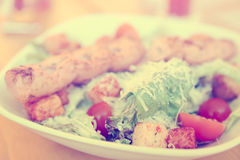 Caesar salad, toned photo Royalty Free Stock Images