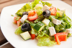 Caesar salad on a white plate Royalty Free Stock Photos