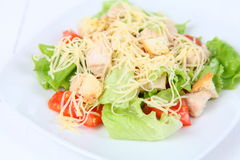 Caesar salad. In a white plate on a wooden table Stock Photography