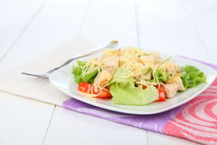 Caesar salad in a white plate Royalty Free Stock Photography