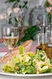 Caesar Salad and wine royalty free stock images