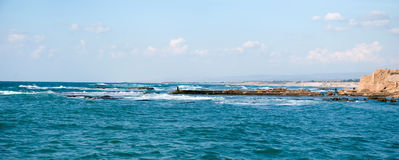 Caesarea, Israel . Old port of Caesarea in Israel with crystal clear water Historical landmark stock photo