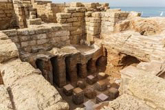 Caesarea, Israel - April 1, 2018: Ruins of ancient Herodian port city in the national park Caesarea Israel. Caesarea, Israel - April 1, 2018: Ruins of ancient stock photography