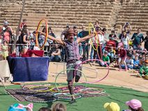 A participant of the Purim festival juggles with hoops for visitors in Caesarea, Israel. Caesarea, Israel, March 03, 2018 : A participant of the Purim festival Royalty Free Stock Photo