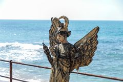 A participant of the Purim festival stands dressed in a fairy statue costume in Caesarea, Israel. Caesarea, Israel, March 03, 2018 :  A participant of the Purim Stock Photo
