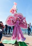 A participant of the Purim festival stands dressed in a fairy statue costume in Caesarea, Israel. Caesarea, Israel, March 03, 2018 :  A participant of the Purim Royalty Free Stock Photography