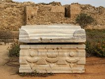 Caesarea, Israel - October 17, 2010: Ancient Roman stone architectural artifact discovered during the excavation of Caesarea arch. Eological site, Israel royalty free stock photo