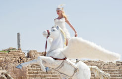 CAESAREA - MARCH 4: Purim celebrations parade, girl on a horse in Ceasearea, Israel on March 4, 2015 Royalty Free Stock Image
