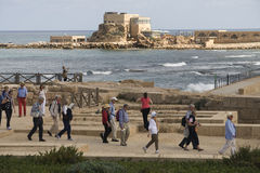 Caesarea Mediterranean. Visitors walk along the reconstruction of the  Caesarea in Israel Stock Image