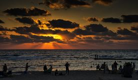 Caesarea in sunset in cloudy day. The beach of the Aquaeductus at Caesarea in sunset Israel Royalty Free Stock Photos
