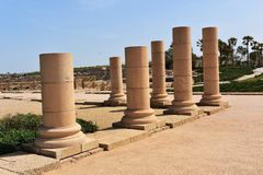 Remains of ancient columns from the Roman period in Caesarea, Israel. Caesarea was a Roman city named after the Caesar and built by King Herod the Great stock image