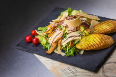 Caesars salad on black background Royalty Free Stock Photos