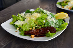 Caeser salad plate with caramelized beef Royalty Free Stock Images