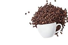 Café aislado Bean Spilling de la taza Foto de archivo libre de regalías
