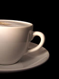 Café au lait. Closeup white cup of  warmly milk Royalty Free Stock Image