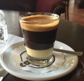 Café Bon Bon. An espresso shot over sweetened condensed milk Stock Image