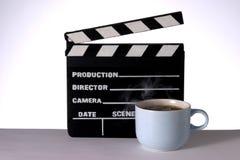Café caliente y Clapperboard Imagen de archivo libre de regalías