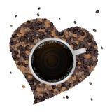 Café chaud avec la forme de coeur des grains de café Photo libre de droits