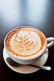 Café con arte de la espuma Fotografía de archivo libre de regalías