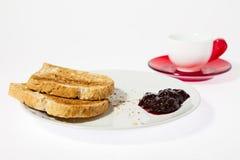 Café con el atasco y el pan Imagen de archivo