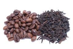 Café contra o chá Foto de Stock Royalty Free