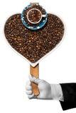 Café d'amour - grains de café en forme de coeur Photographie stock