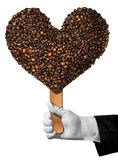 Café d'amour - grains de café en forme de coeur Photo stock