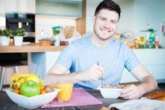 Café da manhã do homem novo Foto de Stock Royalty Free