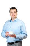 Café da terra arrendada do homem novo (ou chá) Fotos de Stock