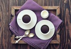 Café dans des tasses Photos stock