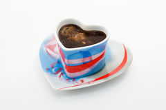 Café dans une cuvette sous forme de coeur Image libre de droits