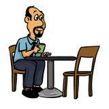 Café de consumición que se sienta del hombre en una mesa de centro Imagen de archivo