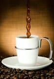 Café de derramamento Foto de Stock Royalty Free