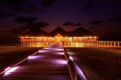 Café de l'eau au coucher du soleil - Maldives Photographie stock libre de droits
